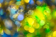 光抽象bokeh与世界地图的 图库摄影