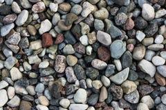 光滑的回合色的水石头 库存图片