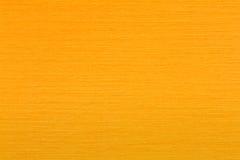 光滑的淡桔色的毛毡织品背景纹理顶视图 免版税库存图片