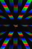 光的绕射图的照片从白炽螺旋的,得到在两个衍射光栅帮助下 图库摄影
