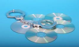 光盘手铐 免版税库存图片