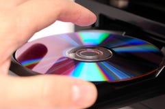 光盘插入 免版税库存图片