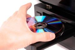 光盘插入 免版税图库摄影