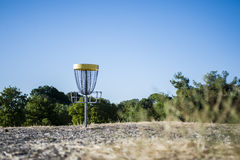 光盘高尔夫球篮子 图库摄影