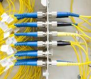 光纤在墙壁箱子的插接线 库存图片