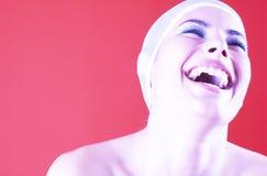 光芒四射的微笑的妇女 图库摄影