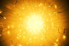光诗歌选,抽象被弄脏的被带领的淡桔色的点燃的Bokeh 库存图片