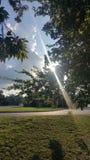 光通过风雨如磐的云彩 库存照片