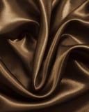光滑的典雅的棕色丝绸或缎作为背景 在乌贼属口气 库存照片