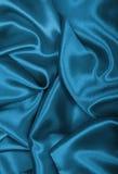 光滑的典雅的蓝色丝绸或缎作为背景 库存照片