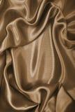 光滑的典雅的金黄丝绸或缎作为背景 在乌贼属口气 图库摄影