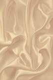 光滑的典雅的金黄丝绸或缎作为背景 在乌贼属口气 库存照片