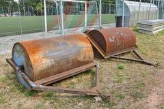 光滑的大重金属的路辗足球场 免版税库存照片