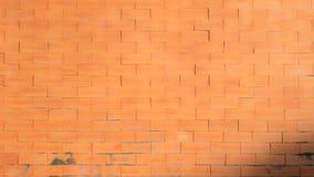 光滑的温暖的橙色砖墙 库存图片