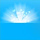 光破裂了蓝色背景 免版税图库摄影