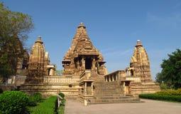 克久拉霍寺庙小组纪念碑在有色情雕塑的印度在墙壁上 免版税库存照片