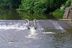 克利松,台阶在河的水中 库存图片