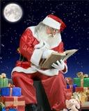 克劳斯他的笔记本屋顶圣诞老人文字 图库摄影