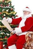 克劳斯列表读取圣诞老人愿望 免版税库存照片