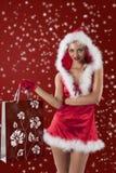 克劳斯女孩性感的圣诞老人 库存图片