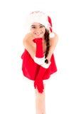 克劳斯小姐佩带圣诞老人帽子吹的亲吻的 免版税库存照片