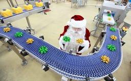 克劳斯工厂礼品圣诞老人 免版税库存图片