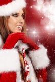 克劳斯给女孩圣诞老人性感佩带穿衣 库存照片