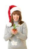 克劳斯给藏品工厂圣诞老人小的妇女穿衣 免版税图库摄影