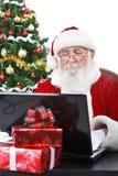 克劳斯膝上型计算机圣诞老人工作 免版税图库摄影