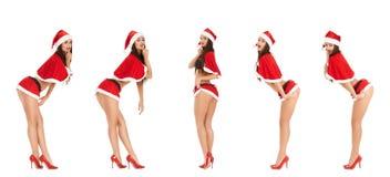 克劳斯给圣诞老人性感的佩带的妇女&# 免版税库存照片