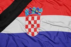 克罗地亚的国旗有黑哀悼的丝带的 免版税库存照片