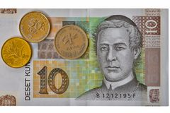克罗地亚货币笔记10 Kuna钞票宏指令和硬币 免版税库存图片
