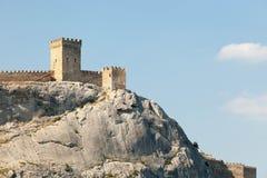 克里米亚 反对蓝天的古老热那亚人的堡垒 库存图片