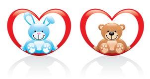 兔宝宝和坐在心脏的玩具熊 库存图片