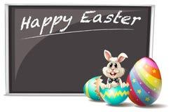 兔宝宝和破裂的复活节彩蛋 免版税库存照片