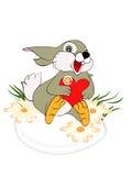 兔宝宝复活节彩蛋相当坐 免版税库存照片