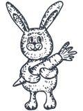 兔宝宝用红萝卜 库存图片