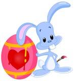兔宝宝被绘的复活节彩蛋 库存例证