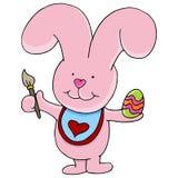 兔宝宝绘画鸡蛋 免版税库存照片