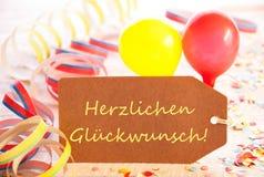 党标签,气球,飘带, Herzlichen Glueckwunsch意味祝贺 免版税库存图片