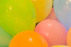 党气球五颜六色的背景 库存图片