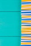 党的吸管在与拷贝空间的蓝色淡色背景 库存照片
