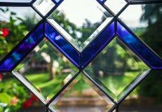 入口与tiffany行间空格特别大的单块玻璃的pvc门 免版税库存图片