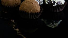 全景巧克力糖的在黑色服务 影视素材
