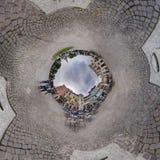 全景村庄方形的下垂的多云天空球孔  库存照片
