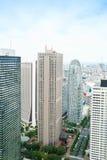 全景现代城市地平线鸟眼睛鸟瞰图在方式下gakuen茧塔在剧烈的太阳和早晨蓝色多云天空下 免版税库存照片