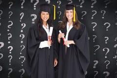 全长射击的综合图象两名妇女毕业 库存图片