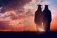 全长射击的综合图象两名妇女毕业 免版税库存图片