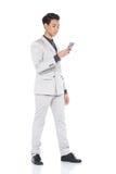 全长短冷期图,在灰色衣服的商人立场气喘a 图库摄影