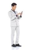 全长短冷期图,在灰色衣服的商人立场气喘a 库存图片